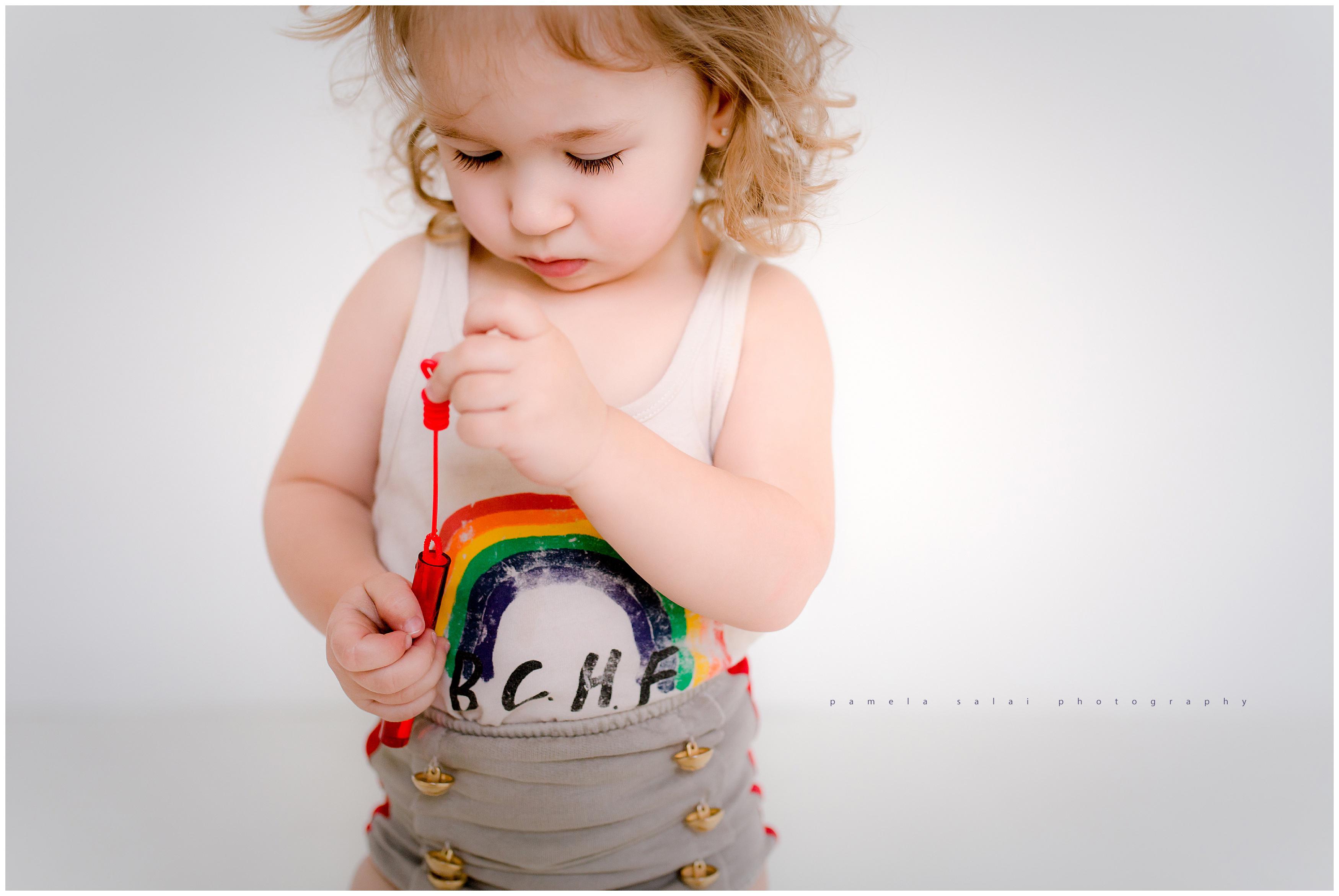 White studio , rainbow, toddler days, life's a circus